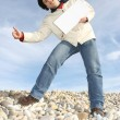 Man Holding White Card at the beach — Stock Photo #1483281