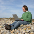 Casual man with laptop at the beach — Stock Photo #1483351