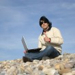 Casual man with laptop at the beach — Stock Photo