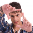 Young man showing framing hand gesture — Stock Photo