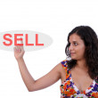 Beautiful woman pressing the sell key — Stock Photo #1486131