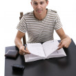 Stock Photo: Young boy studying