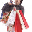 Royalty-Free Stock Photo: Young man full of Christmas gifts