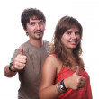 Young Couple showing thumbs up — Stock Photo