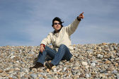Young Man Gestures at the beach — Stock Photo