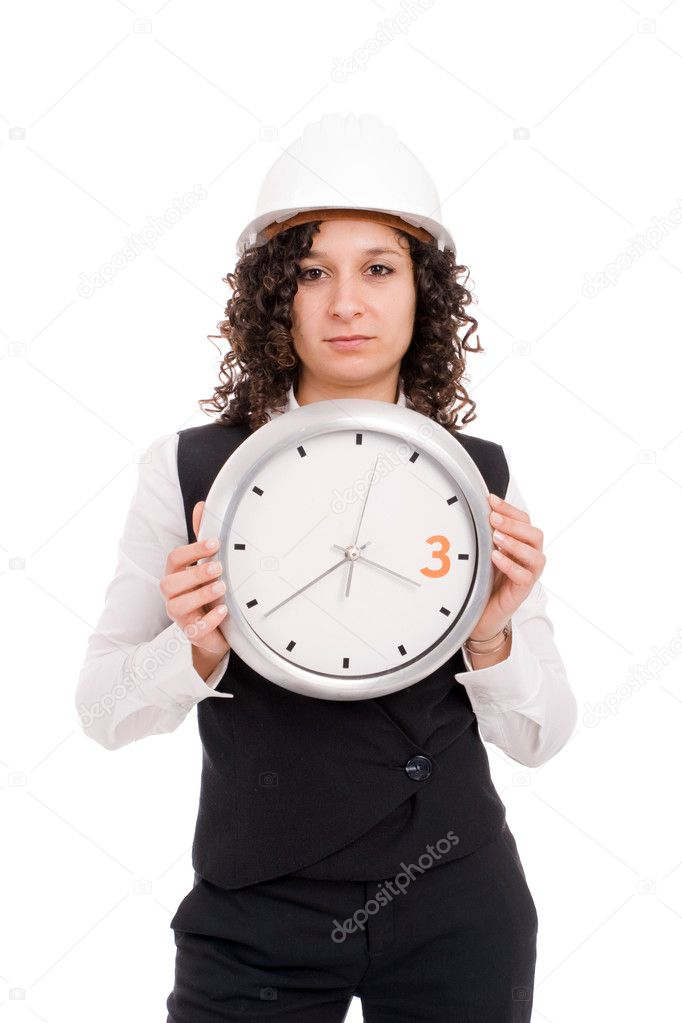 Young engineer holding a clock, isolated over white — Stock Photo #1489785