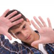 Young man showing framing hand gesture — Stock Photo #1490246