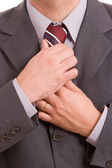 Business man fixing his tie — Stock Photo