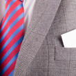 Business card in suit's pocket — Stock Photo