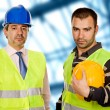 Proud boss and worker standing looking at the camera — Stock Photo #1495581