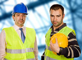 Proud boss and worker standing looking at the camera — Stockfoto