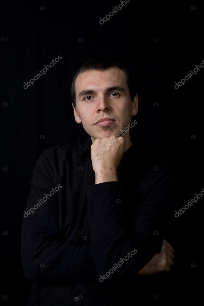 Young pensive man portrait, on a black background — Stock Photo #1501601