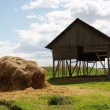 Haystack near the farm against — Stock Photo