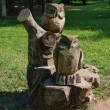 Stock Photo: Wooden sculpture of an owl in the Park