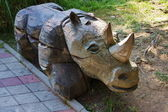 A wooden sculpture of a rhinoceros — Stock Photo