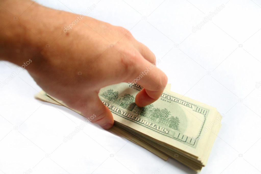 Hand taking ream of dollars, isolated on a white — Stock Photo #1479121