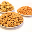 Three plates with different nuts — Stock Photo