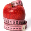 Tape measure wrapped around the apple — Stock Photo #1545624