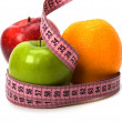 Tape measure wrapped around fruits — Foto de Stock