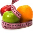 Tape measure wrapped around fruits — Stockfoto