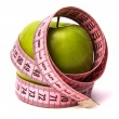 Stock Photo: Tape measure wrapped around the apple