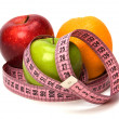 Tape measure wrapped around fruits — Stok fotoğraf