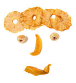 Human face imitation with dried fruits — Stock Photo