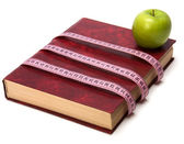 Tape measure wrapped around book — Stock Photo