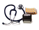 Stethoscope, tablets and doctor seal — Stock Photo
