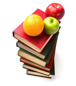 Book stack with fruits — Stock Photo
