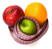 Tape measure wrapped around fruits — Stock Photo