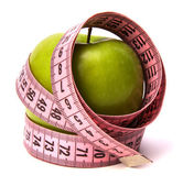 Tape measure wrapped around the apple — Stock Photo