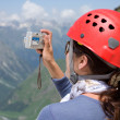 Girl making a photo in mountains — Stock Photo
