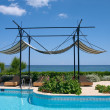 Stock Photo: Couches and sunshade on the sea coast