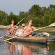 Peoples on canoe - Stock Photo