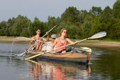 Peoples on canoe — Stock Photo