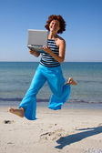 Running woman with laptop — Stock Photo