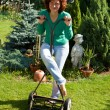 Girl with lawn mower — Stock Photo #1507212