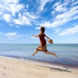 Girl running along sea coast — Stock Photo