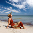 Woman become sunburnt at sea beach — Stock Photo #1507531