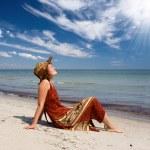 Woman become sunburnt at sea beach — Stock Photo #1507531