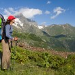 Hiker woman looking to a valley — Stock Photo