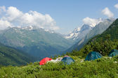 Tent in high mountain — Stock Photo
