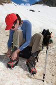 Climber girl wearing the crampon — Stock Photo