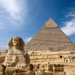 Sphinx and the Great pyramid in Egypt - Stock Photo