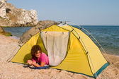 Red-haired girl in tent — Stock Photo