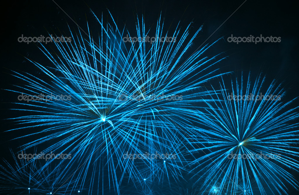 Yellow fireworks stars in black sky — Stock Photo #1515378