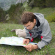 Hiker man looking to the map — Stock Photo