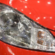 Head lamp of red car — Stock Photo