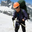 Stock Photo: Happy climber in orange helmet